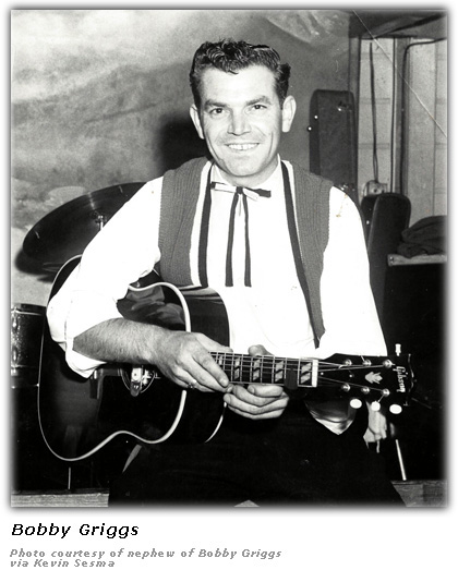 Bobby Griggs with guitar and vest